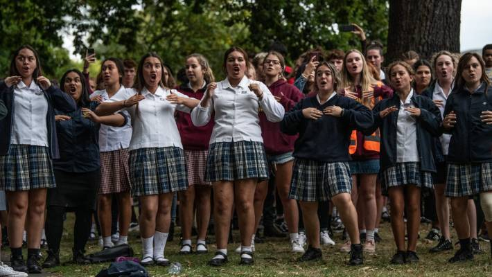Schoolgirls perform a haka during a vigil near the Al Noor mosque in Christchurch.