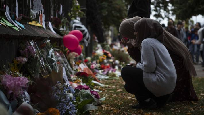 Mourners at the Botanic Gardens in Christchurch after last week's massacre.