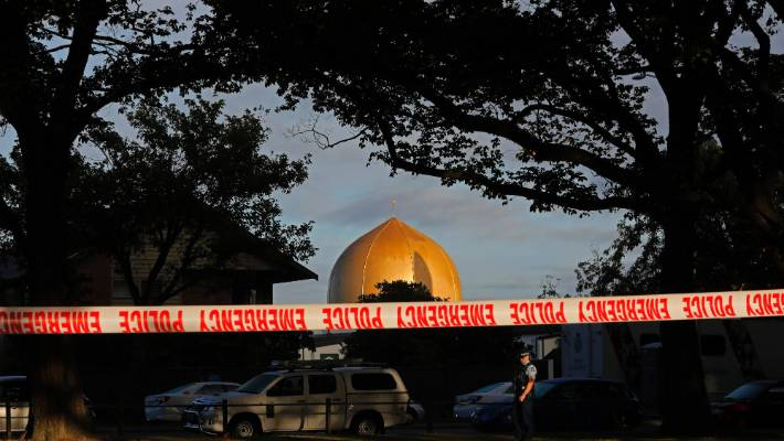 A police officer stands guard in front of the Masjid Al Noor mosque in Christchurch, New Zealand, where one of two mass shootings occurred.