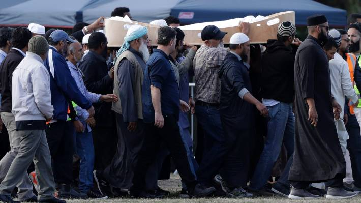Mourners carry the body of a victim of the shootings for burial at the Memorial Park Cemetery in Christchurch.