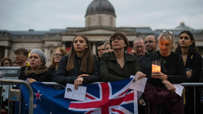 People attend a vigil in Trafalgar Square to honour the victims of the Christchurch mosque shootings.
