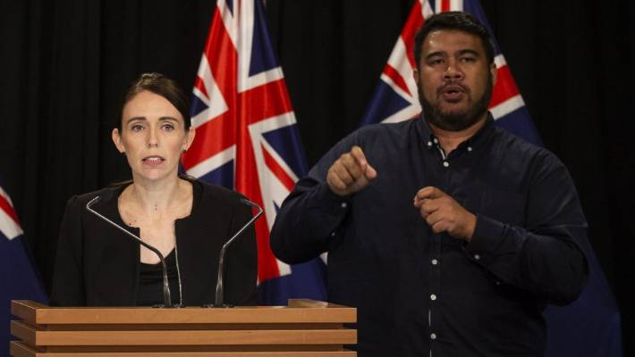 Prime Minister Jacinda Ardern and sign language interpreter Alan Wendt at a parliament press conference after the Christchurch mosque terror attack.