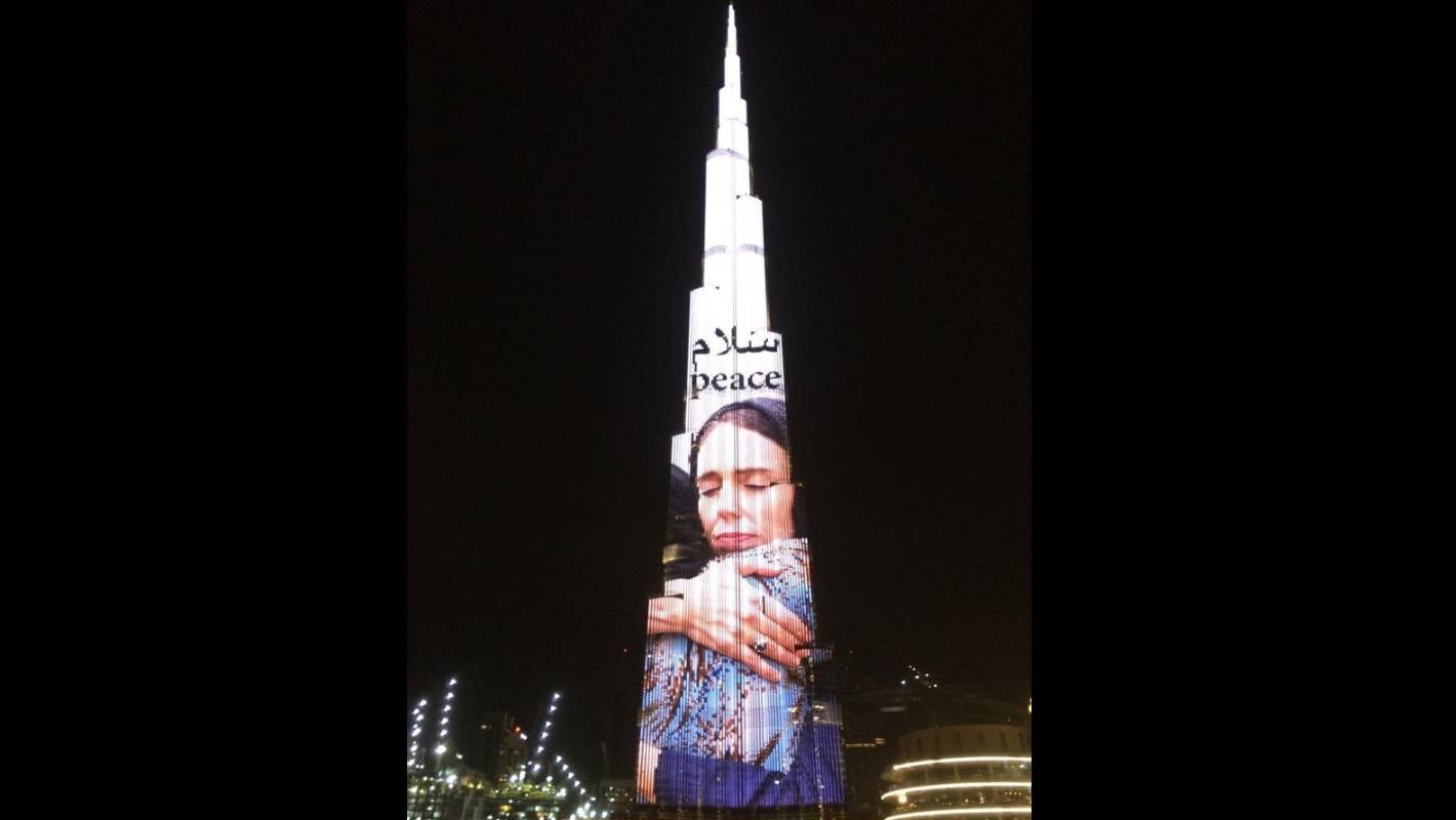 The Burj Khalifa, an 829-metre-tall skyscraper in Dubai, has been lit up with an image of Jacinda Ardern hugging a woman at the mosque in Kilbirnie, Wellington.