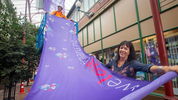 Chris Thompson from Fulton Hogan and Aoraki Development operations manager Di Hay display the new We Love Timaru flags in the Royal Arcade.