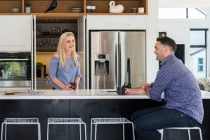 Karyn and Adam Bayliss love to entertain so they designed their home around the kitchen.