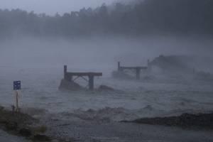 The Waiho Bridge in Franz Josef has been taken out by flood waters.