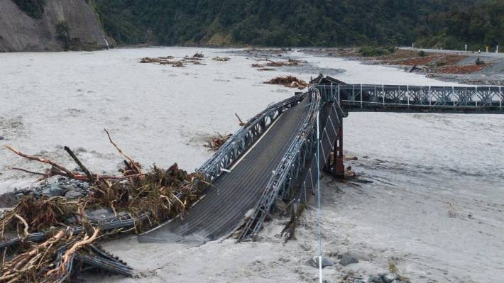 Debris, a rising river bed and floodwaters caused a West Coast