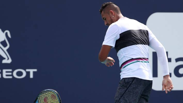 Nick Kyrgios received a code violation for racquet abuse.