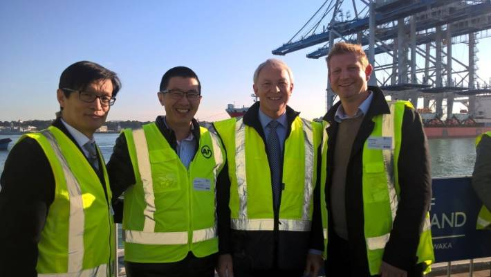 Mayor Phil Goff (2nd from right) and Councillor Paul Young (left) watching the arrival of new container cranes at the port