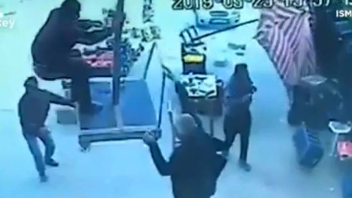 Turkish man blown away while holding onto umbrella