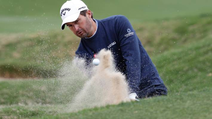 Kevin Kisner plays a bunker shot in his semi-final victory at the World Match Play