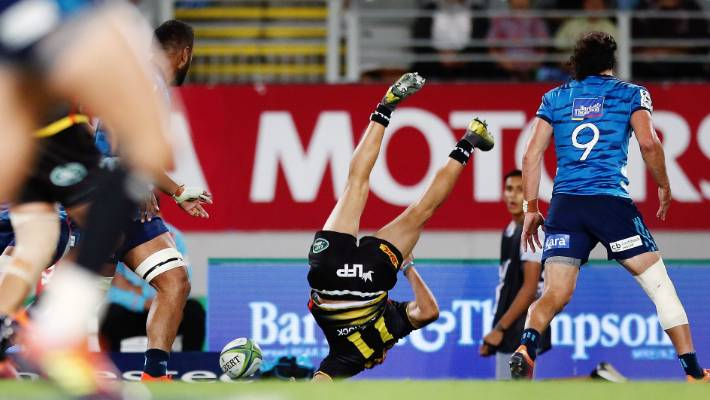 Dillyn Leyds from the Stormers is going to land after a dangerous attack from Tanielu Tele and the Blues.