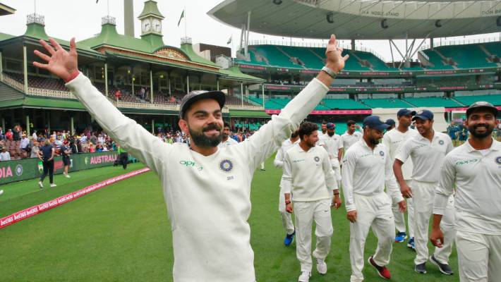 Virat Kohli and the Indian cricket team celebrate winning the series and the Border Gavaskar Trophy in Sydney in January