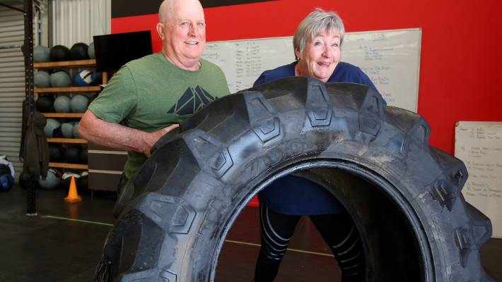 Personal trainer ropes parents into CrossFit workouts with the flip of a tyre