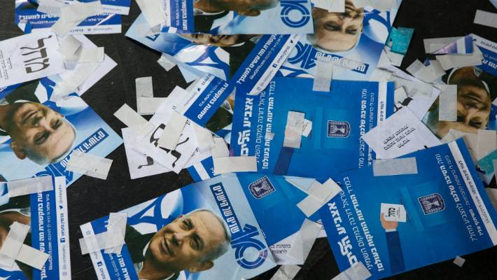 Likud party ballot papers and Israel's Prime Minister Benjamin Netanyahu's campaign fliers are seen on the ground after polls for Israel's general elections closed in Tel Aviv Israel