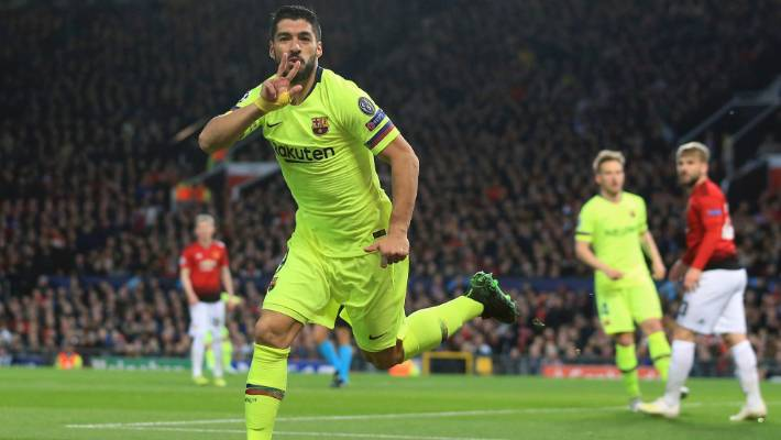 Barcelona's Luis Suarez celebrates after his header led to Luke Shaw's early own goal