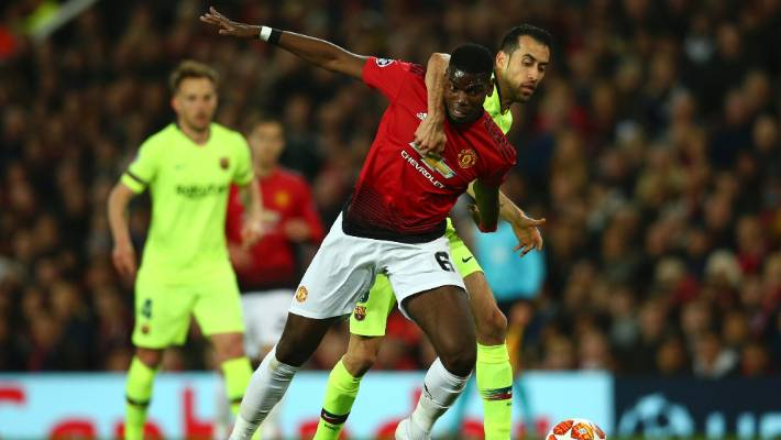 Barcelona's Sergio Busquets right vies for the ball with Manchester United's Paul Pogba