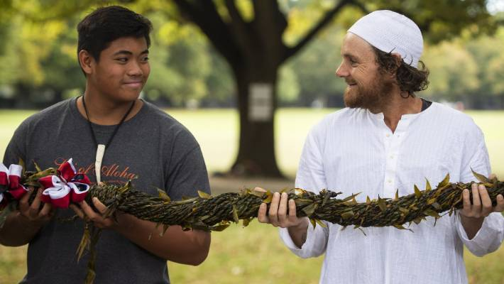 Ethan Villanueva and Musa during a ceremony involving a group from Hawaii presenting a mile-long lei to the Muslim community after the terror attack.