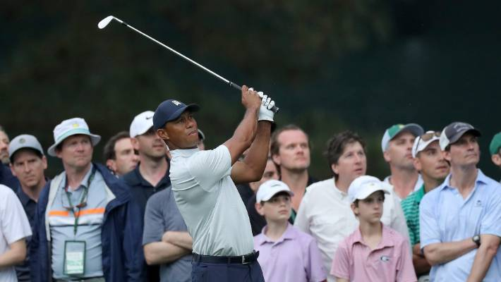 Tiger Woods survives security guard to remain in Masters contention