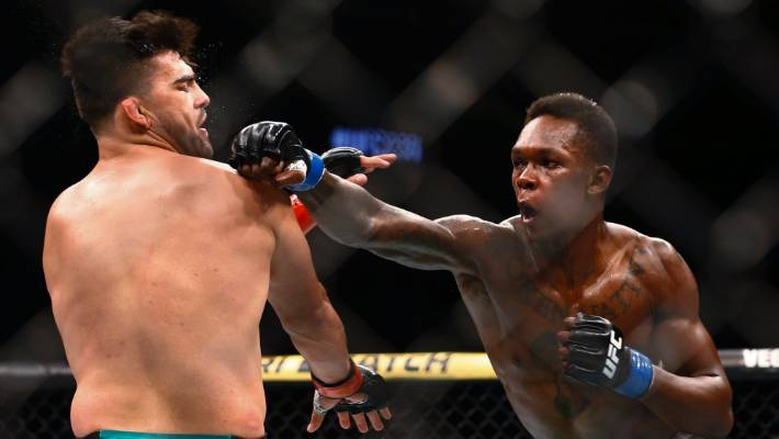 Israel Adesanya lands a right hand on Kelvin Gastelum during their title fight.