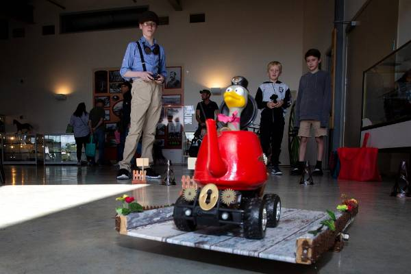Ethan Shirriff from Woodville  (left) demonstrates Duckalan, his remote controlled steam punk racing teapot.