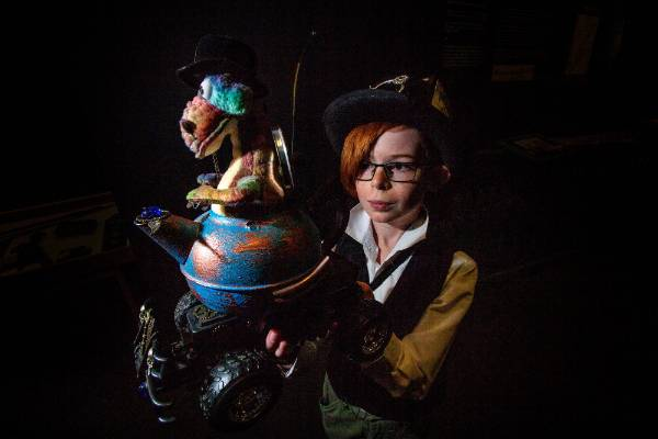 Liam Shirriff, 10, from Woodville dressed for the occasion in his steam punk outfit holds his steam punk remote controlled dinosaur in a teapot vehicle called D-Rex.