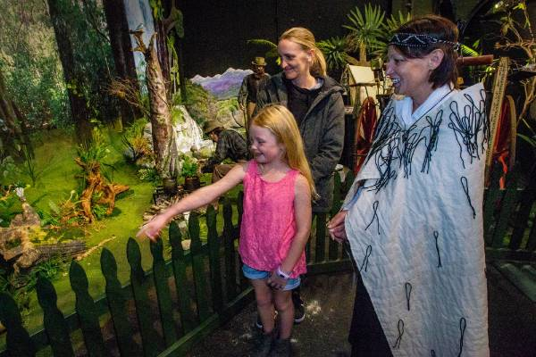 Sarah Holwell and her daughter Saskia Symonds, 7, explore the exhibits in the Coach House Museum with the help of the co-ordinator of the day?s activities, Piki Lowe (right).