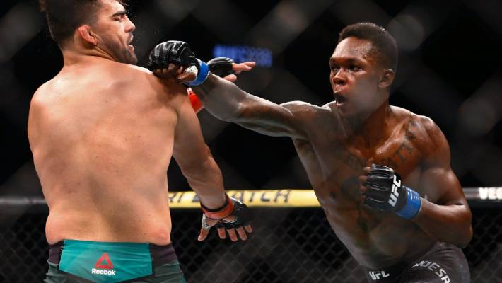 Israel Adesanya surged home in the final round to beat Kelvin Gastelum by unanimous decision.