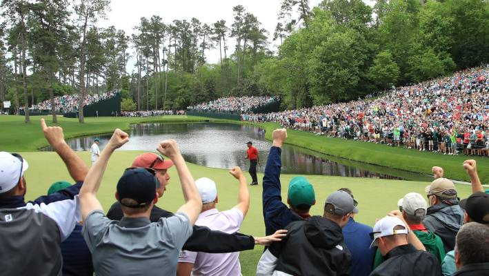 Spectators at Augusta cheer after Woods' win.