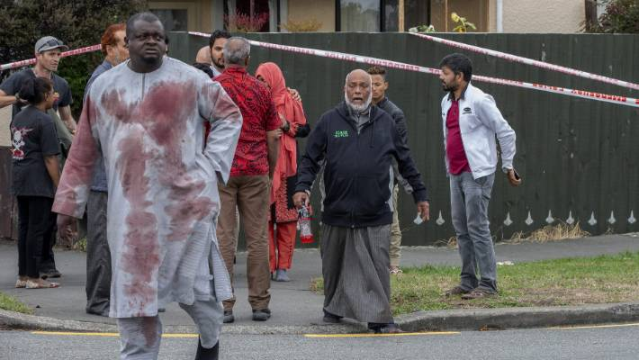 Shocked survivors emerge after the attack on the Linwood Masjid on March 15.