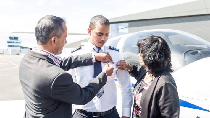 Gevnesh Prasad's parents helping him put on his wings in March.