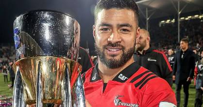 Richie Mo'unga celebrates with the Super Rugby trophy after guiding the Crusaders to the title against the Lions last year.