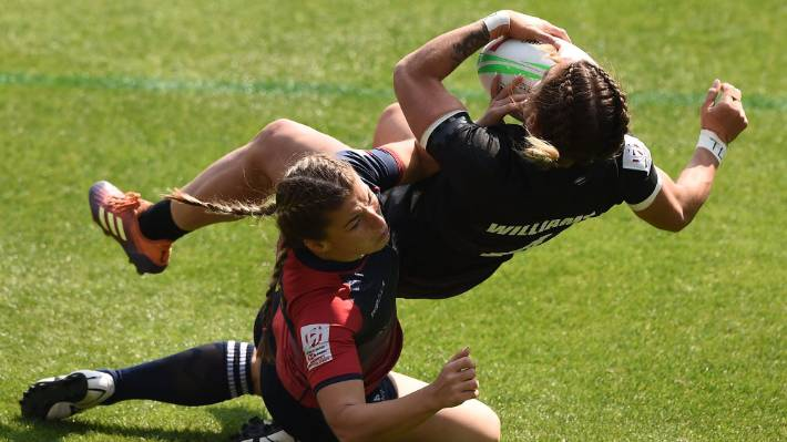 Niall Williams of New Zealand gets dumped on her back in a tackle in the draw against Russia