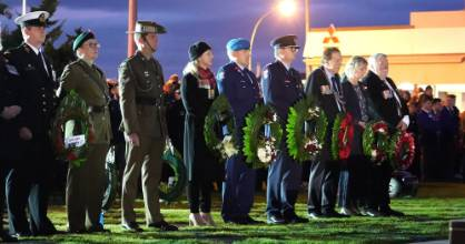 Warrant Officer Peter Patton of the Royal New Zealand  Navy, on the left, with officials attending the 2019 ANZAC  ...