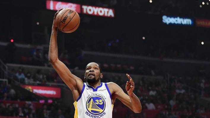 9f571bb1842f Golden State Warriors forward Kevin Durant drives for a lay-up against the  Los Angeles