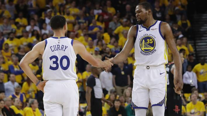 quality design 63b78 ada1c Golden State Warriors  Kevin Durant with team-mate Stephen Curry in their  opener against