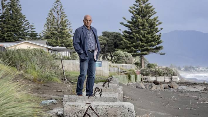 Kāpiti Mayor K Gurunathan at Raumati beach, where the council is working to shore up a temporary sea wall.