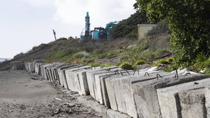 The council is using stones and blocks to firm up a temporary sea wall, built in 2016.