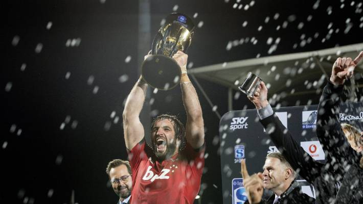 The victorious Captain of the Croats, Sam Whitelock, raises the Super Rugby trophy after the end of last year.
