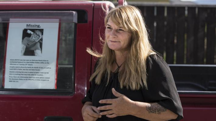 Kay Johnstone, mother of missing Marlborough woman Jessica Boyce, stands in front of the red ute Boyce took to Lake Chalice. A missing person's poster sits in the ute's window.