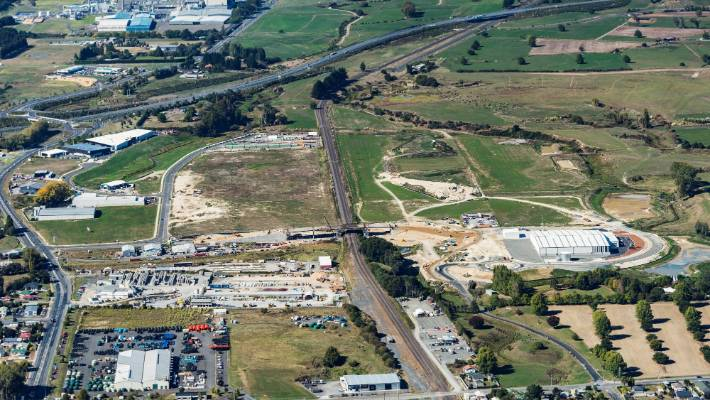 This drone image shows the Ports of Auckland Waikato Freight Hub and its proximity to SH1 for road and the main trunk line for rail. The large warehouse (centre right) will be leased by Open Country Dairy.