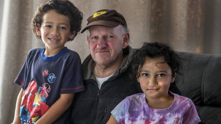 Raymond, with his children Dray, 8, left, and Renee, 9. The children spend five nights at Cholmondely Children's Centre every six weeks, to give him respite.