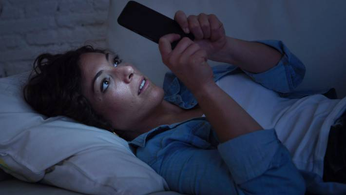 Blue light emitted from phones and laptop screens can actually wake you up.