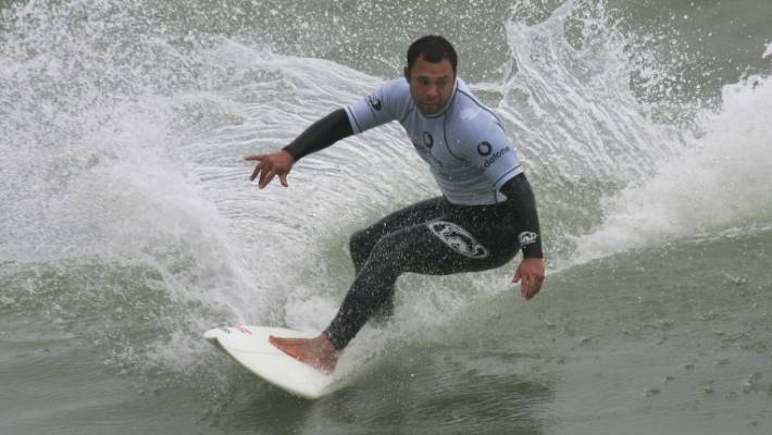 Sunny Garcia, seen here competing in the event at the beach pushing Oakland in 2005, seriously ill in the hospital.