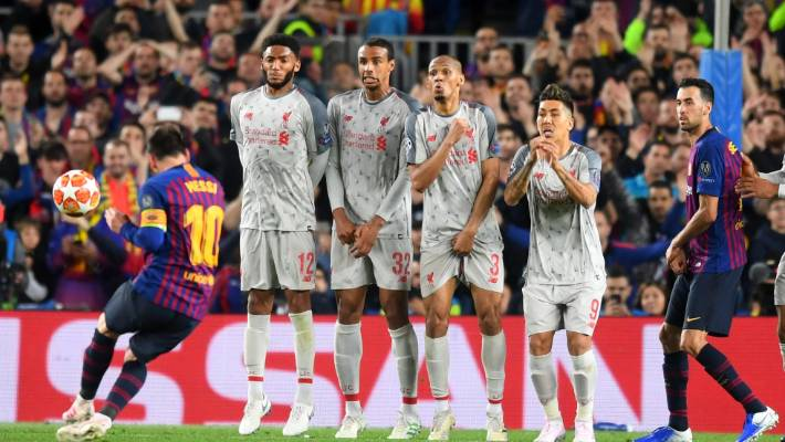 dbf107f3bec Barcelona s Lionel Messi bends his freekick round the Liverpool wall to put  his side 3-