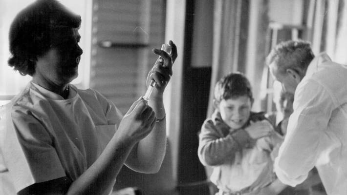 Polio vaccines wiped out the disease in New Zealand. Here a boy gets jabbed at Orakei School in September 1956.