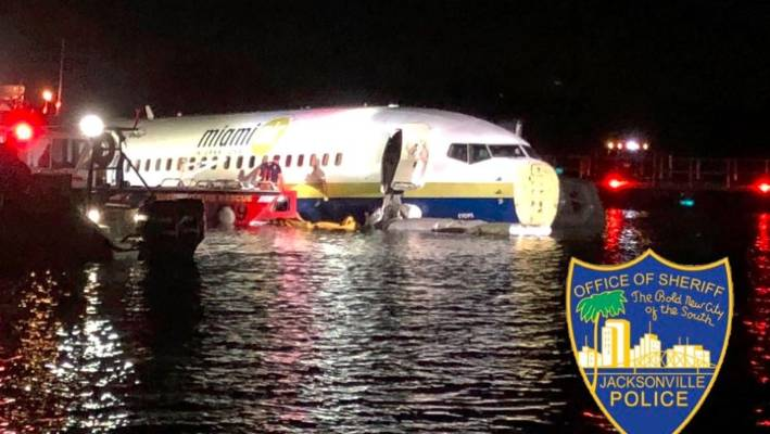 Plane carrying 142 people skids off Florida runway, plunges into river