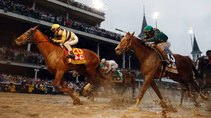 Flavien Prat rides Country House to the finish line at the 145th Kentucky Derby.