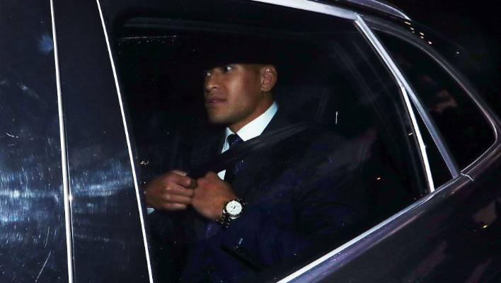 Israel Folau departs after Rugby Australia's code of conduct hearing.