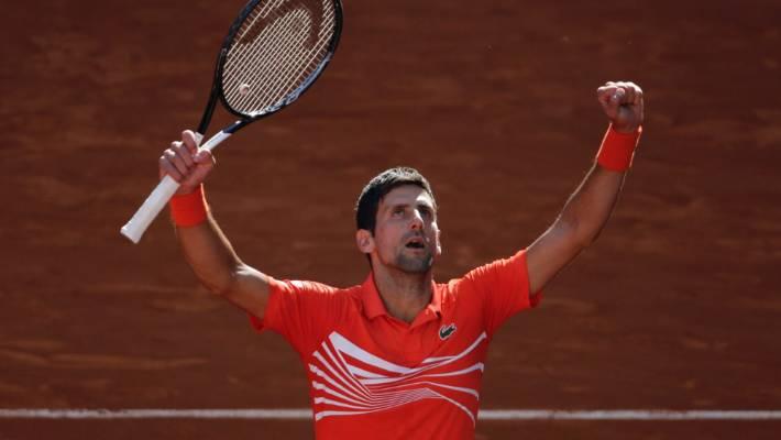 Novak Djokovic of Serbia celebrates after beating Dominic Thiem of Austria to make the Madrid Open tennis final.